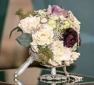 Broach bouquet made of beautiful broaches and silk flowers