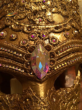 Close-up of mask adorned with Swarovski crystals